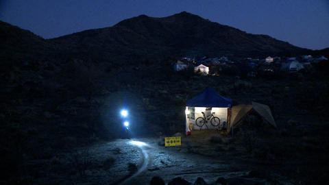 A cyclist rides at night using lights Stock Video Footage