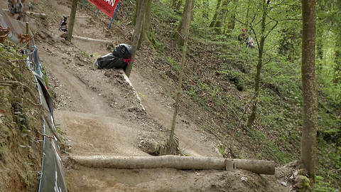 Cyclist race along a rough dirt road course Stock Video Footage