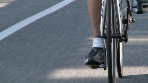 A bicyclist rides down a highway Stock Video Footage
