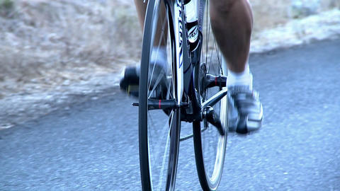 A man rides a bicycle down the street Stock Video Footage