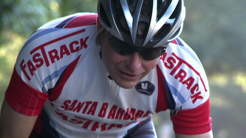 A man rides a bicycle in a race Stock Video Footage