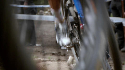Bicyclists race as a crowd watches Stock Video Footage