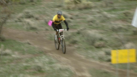 A cyclist races through rough terrain Stock Video Footage