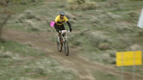 A cyclist races through rough terrain Footage