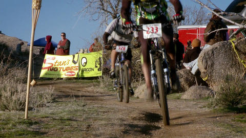 Bicyclists race through a hilly area Stock Video Footage