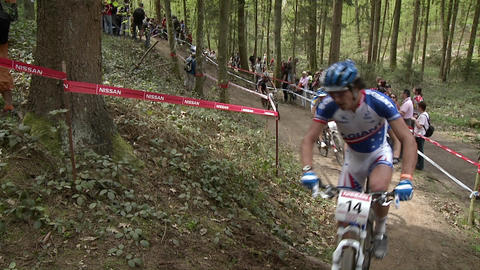 Bicyclists race in a competition Stock Video Footage