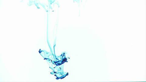 Blue ink is dropped into another liquid and makes... Stock Video Footage