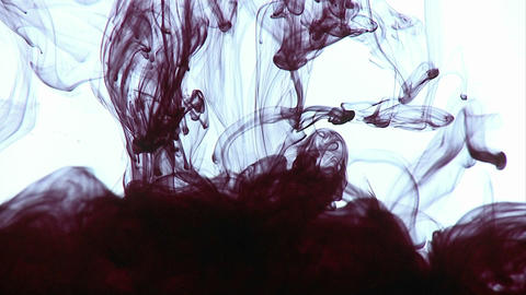 Ink is dropped into water, creating interesting designs Footage