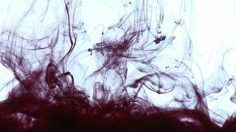 Ink is dropped into water, creating interesting designs Stock Video Footage