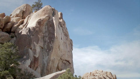 People are climbing up the side of a mountain Stock Video Footage