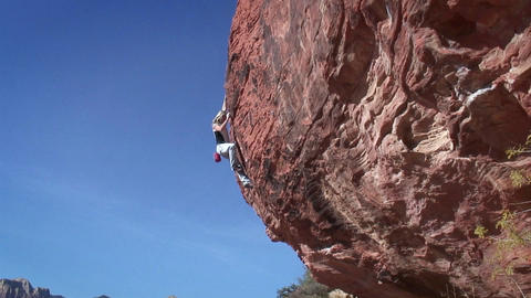 A woman climbs a rock Stock Video Footage