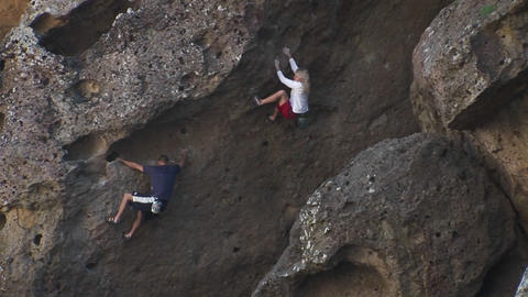 Two people are climbing up the side of a mountain Stock Video Footage