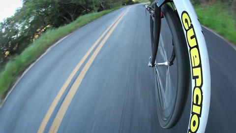 A bicycle is pushed down a street Stock Video Footage