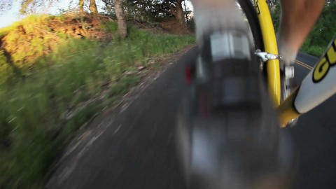 A bicycle is being ridden down a street Stock Video Footage
