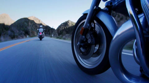Two motorcycle riders take to the open road in the... Stock Video Footage