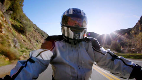A man rides a motorcycle in the country side Stock Video Footage