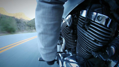 A motorcycle is being ridden down a mountain highway Footage