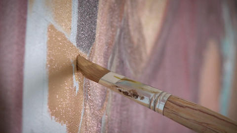 An artist works on a painting on their easel Stock Video Footage
