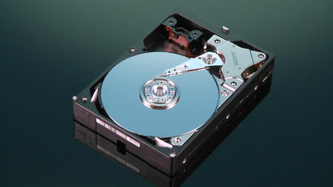 Hard drive without cover spins slowly around Stock Video Footage