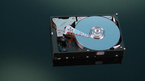 A hard drive with out its cover pans by Footage
