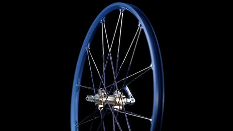 A blue wheel with spokes revolves Stock Video Footage