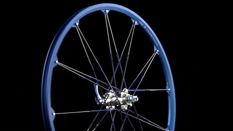 A blue wheel with spokes revolves Footage