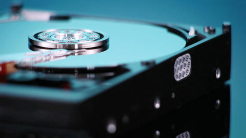 A hard drive without its cover rotates slowly Stock Video Footage