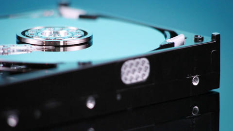 A hard drive without its cover rotates slowly Footage
