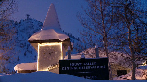 A hillside clock and sign structure is illuminated in the... Stock Video Footage