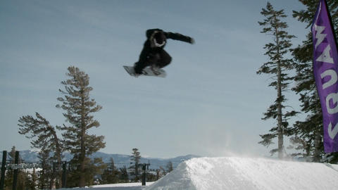 A snowboarder makes a jump Stock Video Footage