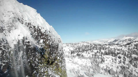 A skier jumps off the side of a mountain, and another... Stock Video Footage