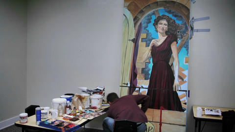 An artist works on a painting Footage