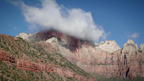 Clouds hang low over a mountain top Stock Video Footage