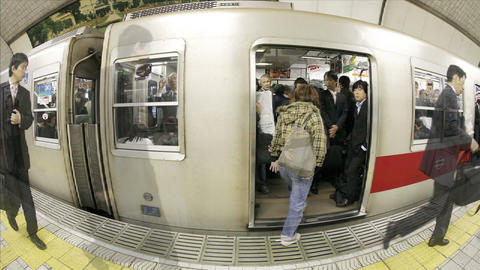 Passengers enter and exit subway cars in Osaka, Japan Stock Video Footage