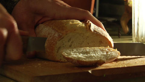 Hands slice loaves of bread Stock Video Footage
