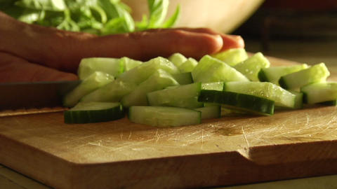 Hands slice cucumbers with a knife Footage