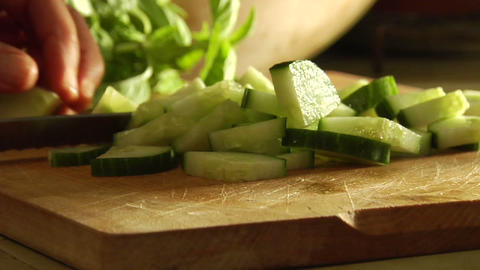 Hands slice cucumbers with a knife Stock Video Footage