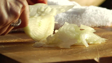 A woman shreds an onion on a cutting board Stock Video Footage