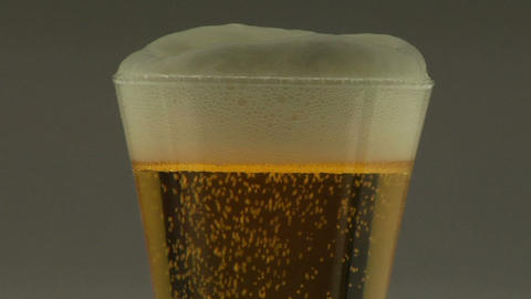 Foam tops a glass of beer Stock Video Footage