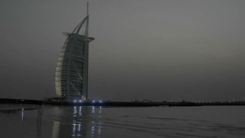 Day turns to night in this time lapse shot of Dubai with the Burj al Arab behind Footage