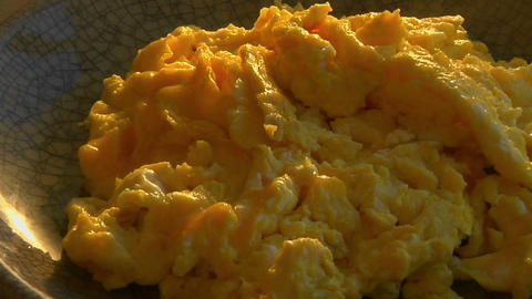 A slow pull into a bowl of scrambled eggs Footage