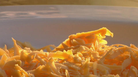 Grated cheese falls on the top of steaming scrambled eggs Footage