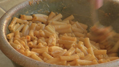 Macaroni is stirred in a bowl Footage