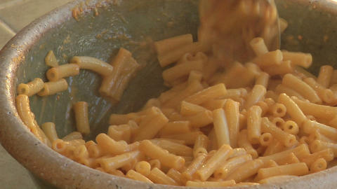 Macaroni is stirred in a bowl Stock Video Footage