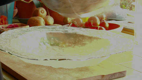 A woman chef prepares a meal by pouring fresh cooked... Stock Video Footage