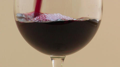 A slow motion pour of red wine into a wine glass Stock Video Footage