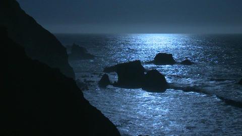 Surf rolls into the Big Sur Coastline of California under... Stock Video Footage