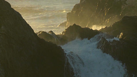 Surf, powered by a winter storm, rolls into the Big Sur Coastline of California Footage