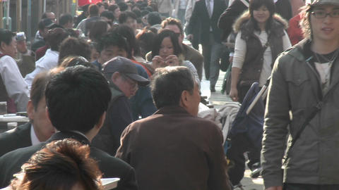 A crowded food stall in Ueno Park during the cherry... Stock Video Footage