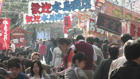A crowded food stall in Ueno Park during the cherry blossom season in Tokyo, Japan Footage